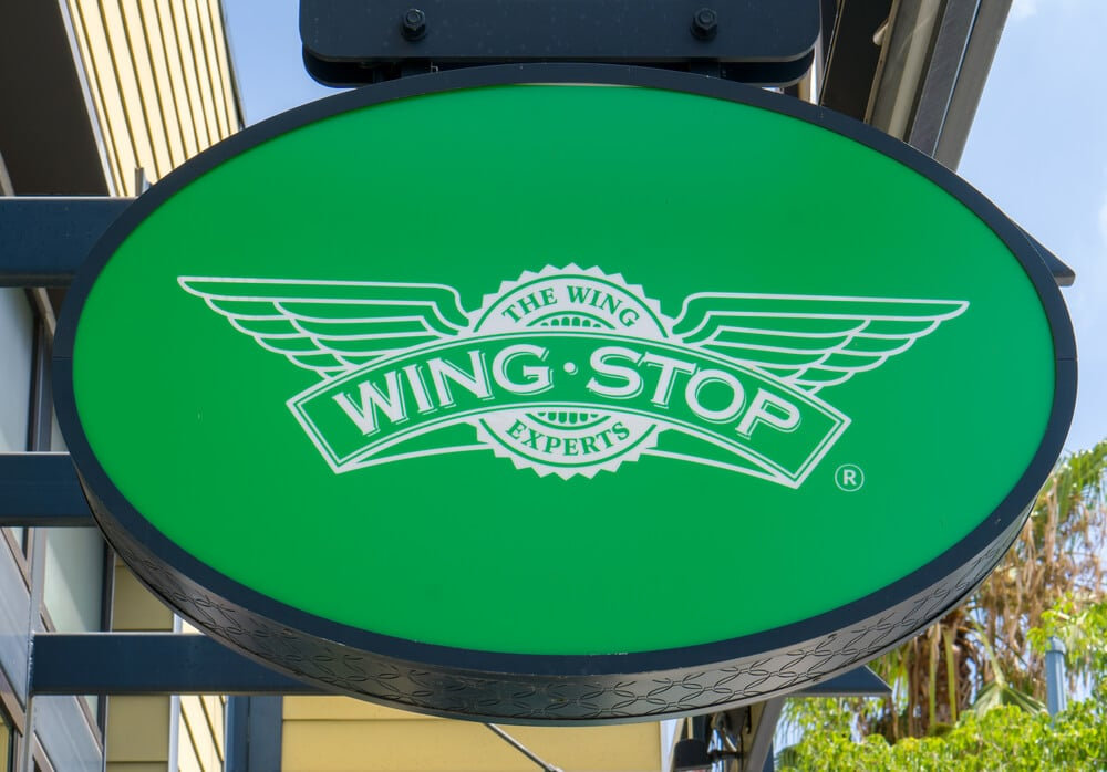 Wingstop sign outside of a restaurant on a sunny day